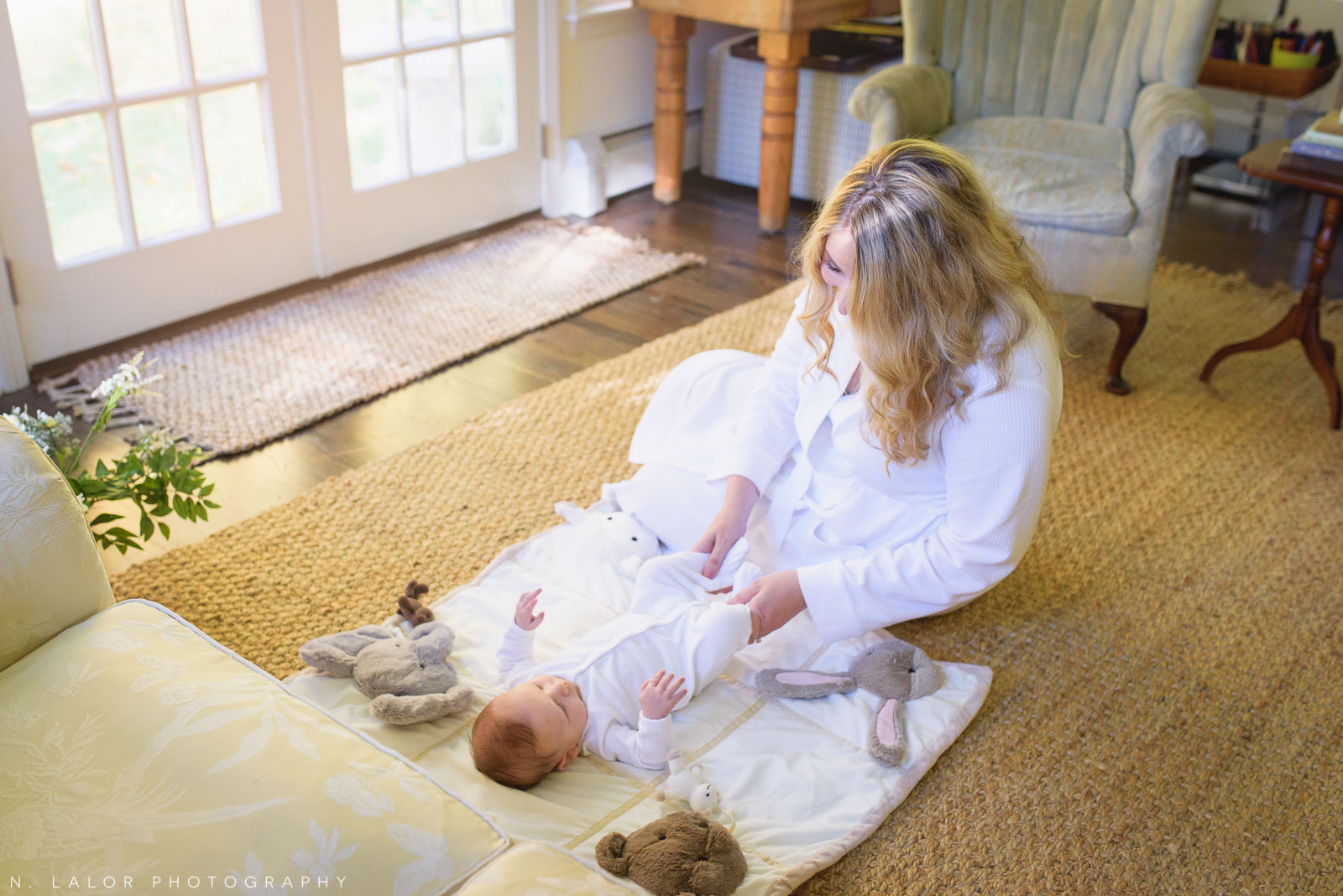Baby morning exercises on the floor play mat. Photo by N. Lalor Photography. Fairfield County, Connecticut.