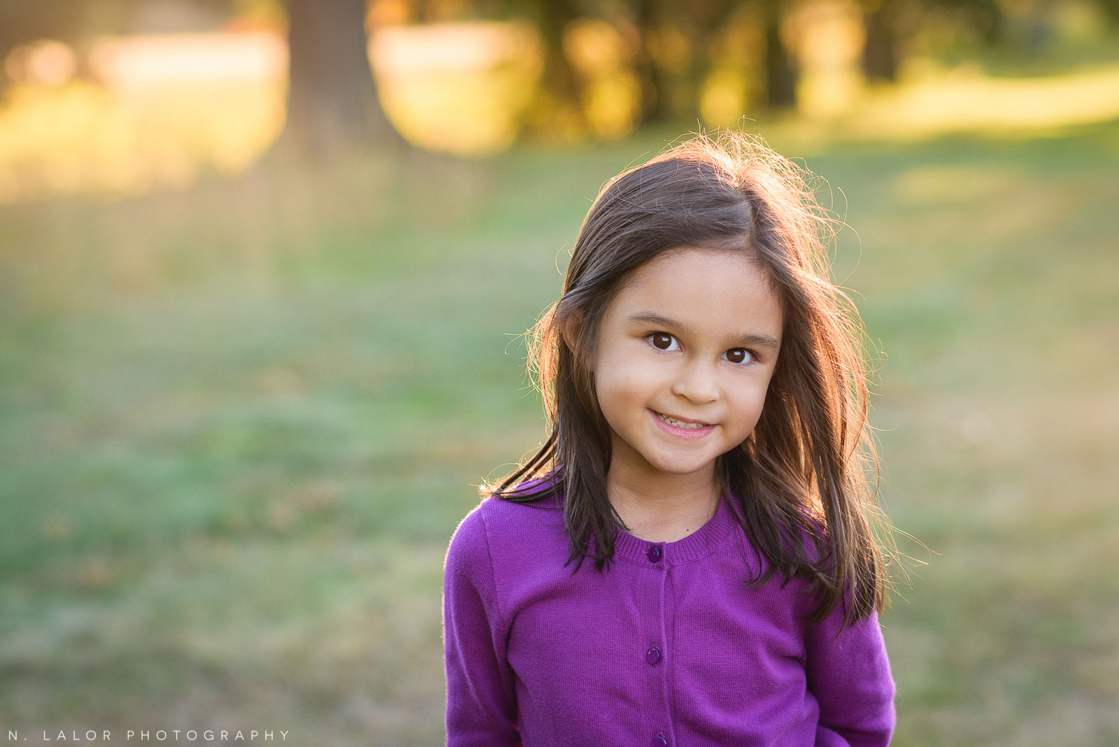 Sweet portrait of a 5-year old girl during the golden hour at Waveny Park. Photo by N. Lalor Photography.