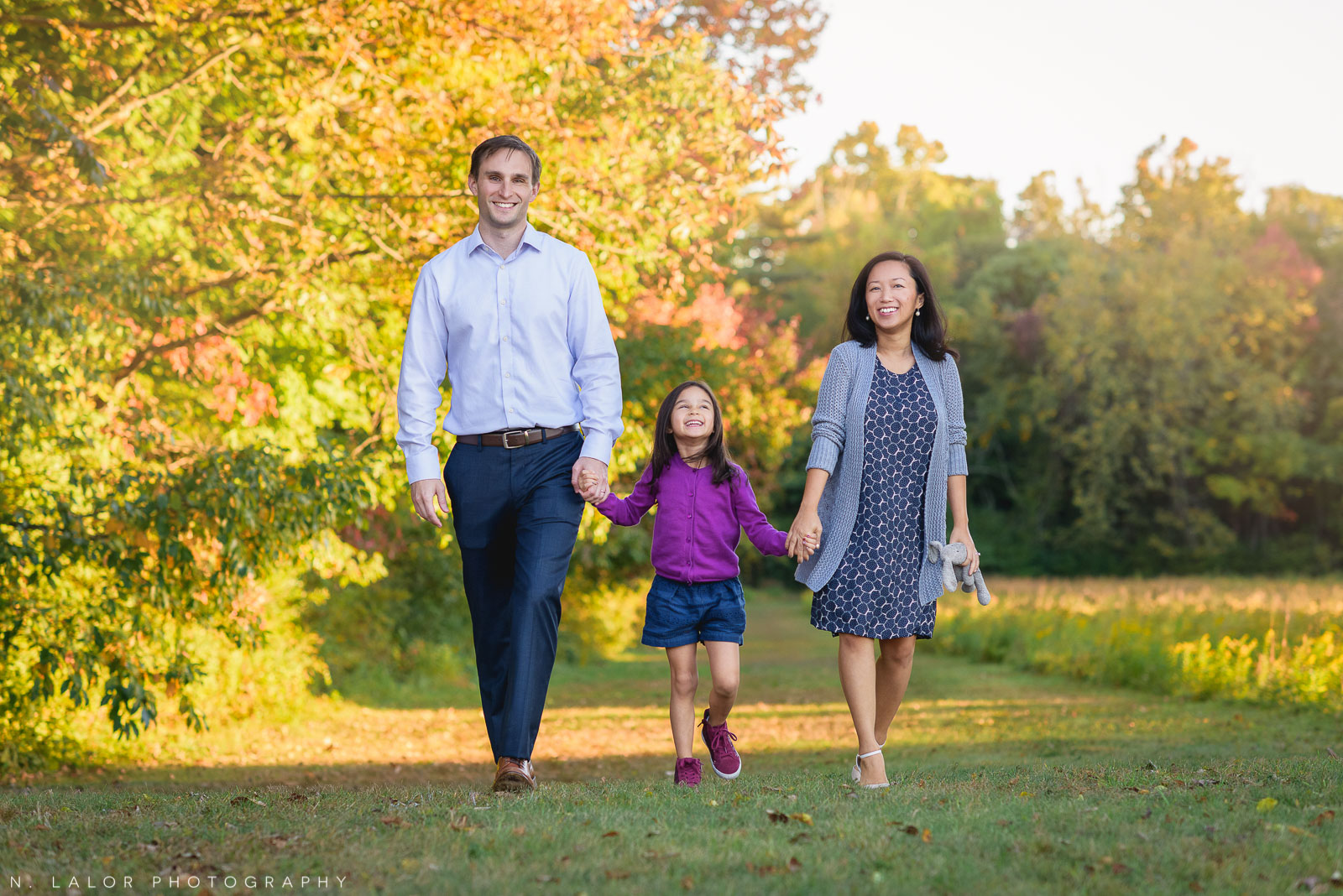 Fun and lovely lifestyle family photo at Waveny Park New Canaan Connecticut by N. Lalor Photography.