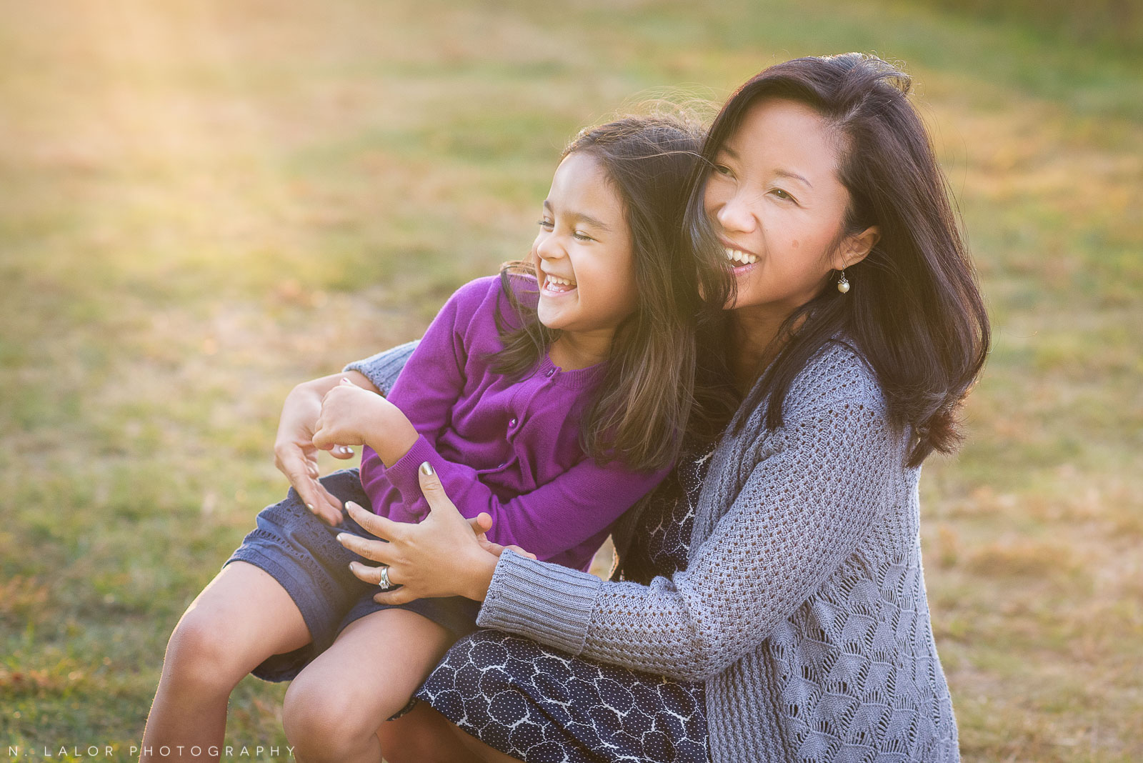Laughing Mom and Daughter. Lifestyle portrait by N. Lalor Photography.