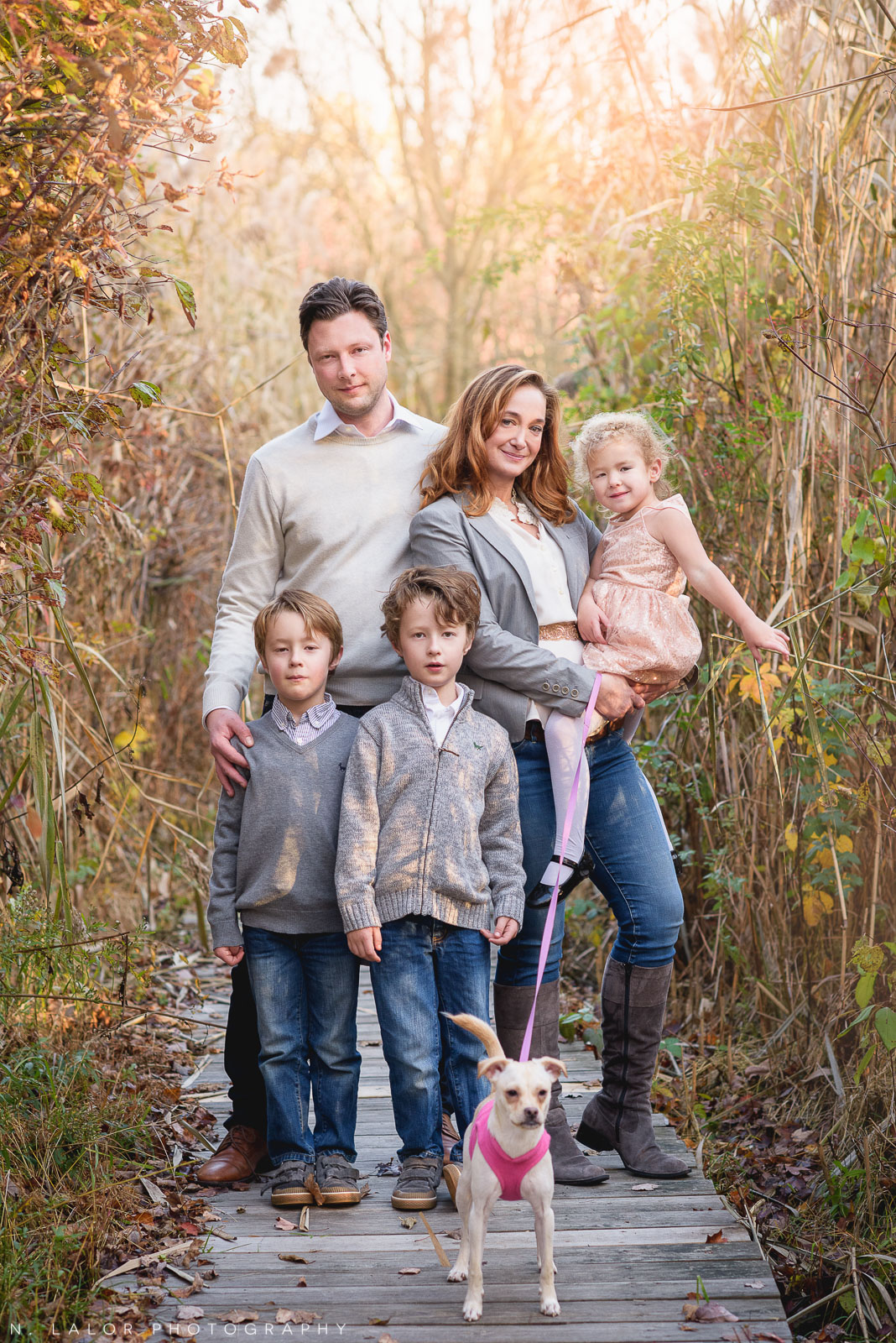 Family photo with twin boys, their little sister, and the family dog. Portrait by N. Lalor Photography. New Canaan Nature Center.