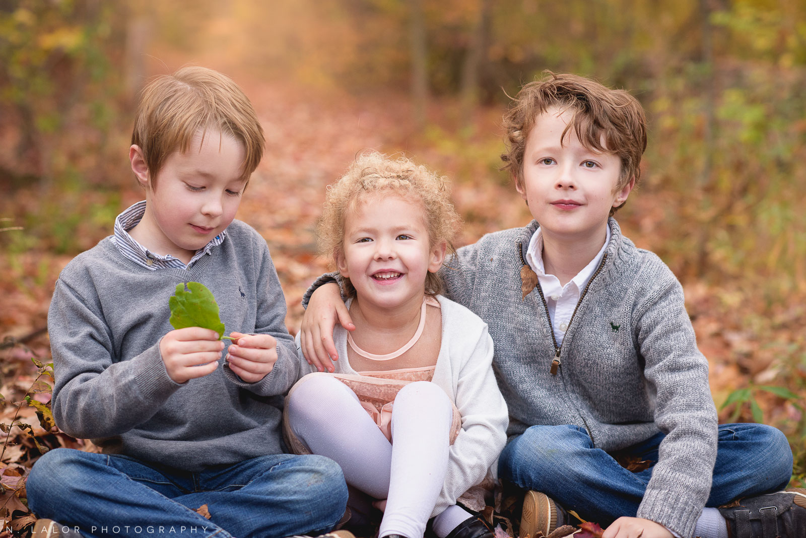 Siblings. Twin boys and their younger sister. Lifestyle portrait by N. Lalor Photography. New Canaan Nature Center.