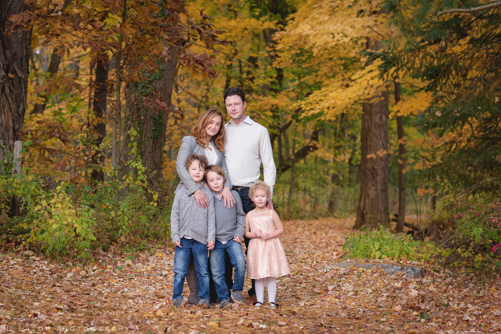 The perfect family shot with three kids. Portrait by N. Lalor Photography. New Canaan Nature Center.