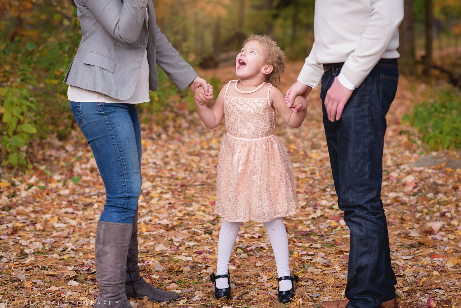 Being the little sister. 4-year old girl with her parents. Lifestyle portrait by N. Lalor Photography. New Canaan Nature Center.