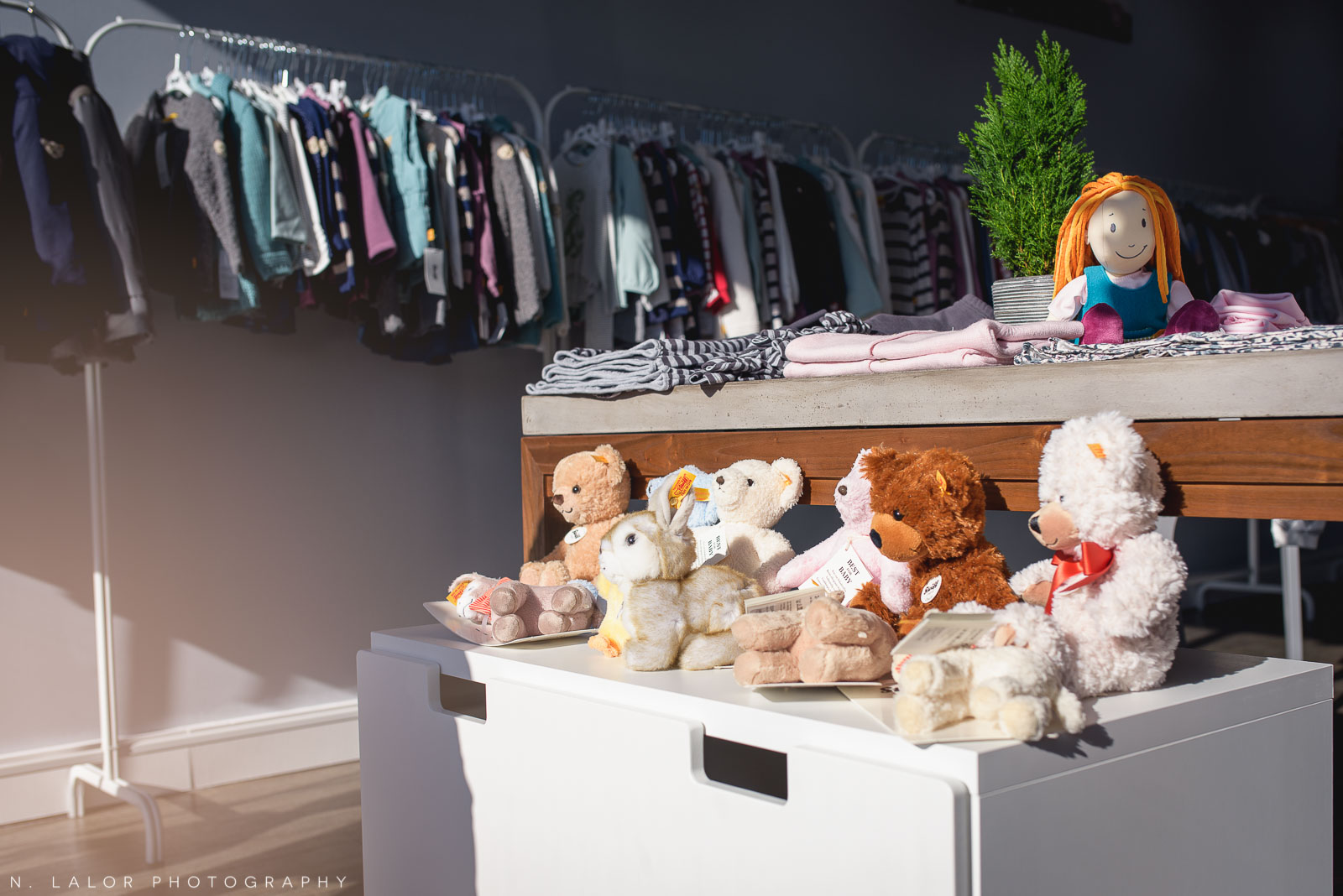 Stuffed teddy bears by Steiff and kids clothing at Ella & Henry in New Canaan, CT. Photo by N. Lalor Photography.