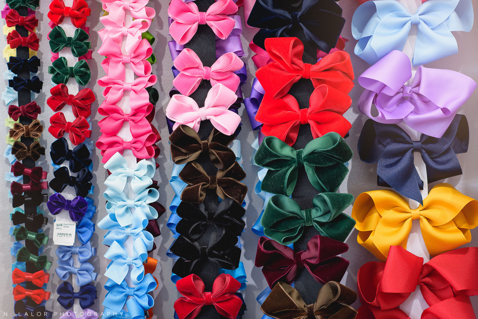 Girl bow accessories galore at Ella & Henry in New Canaan, CT. Photo by N. Lalor Photography.