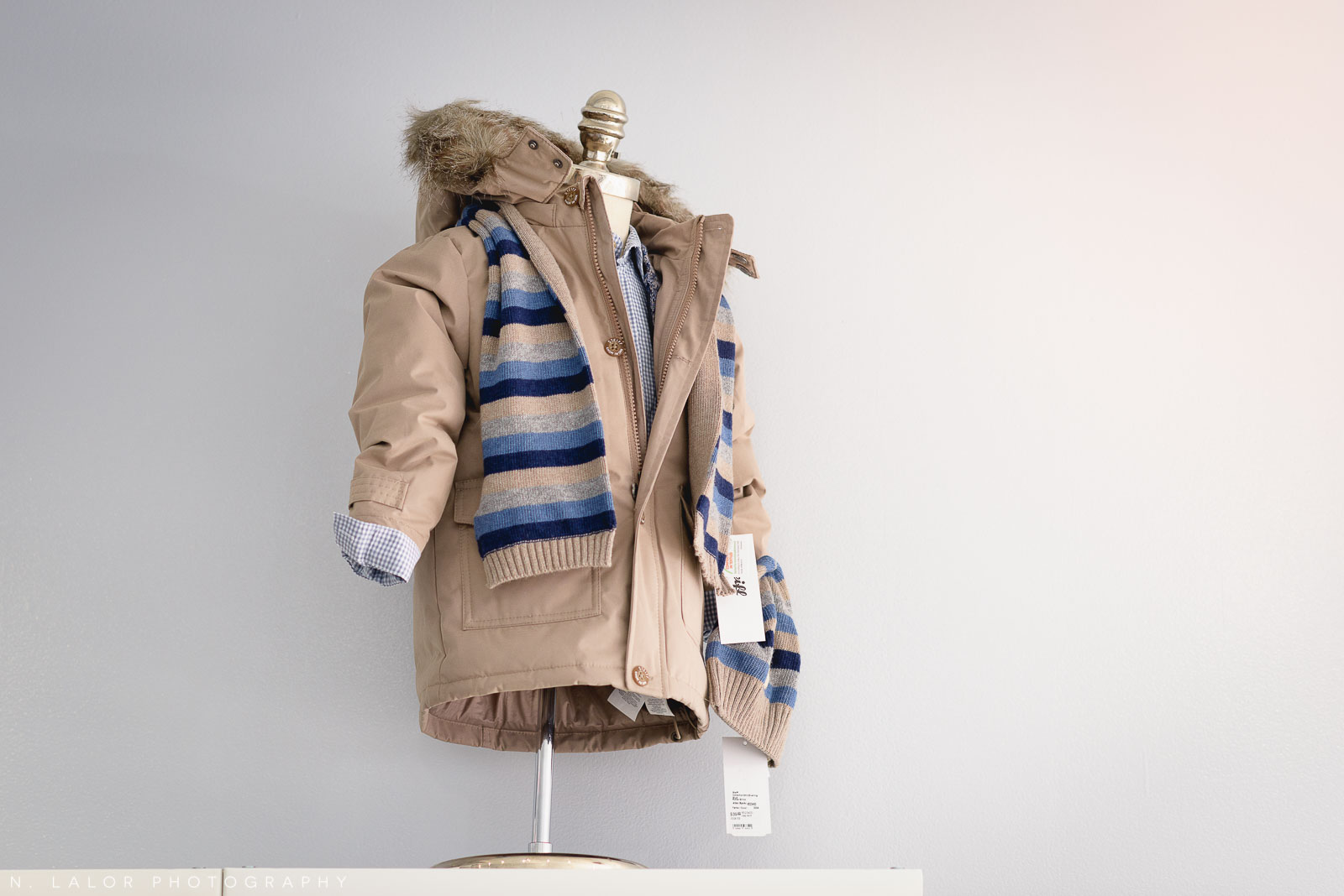 Winter jacket and scarf. Stylish clothing for kids at Ella & Henry in New Canaan. Photo by N. Lalor Photography.