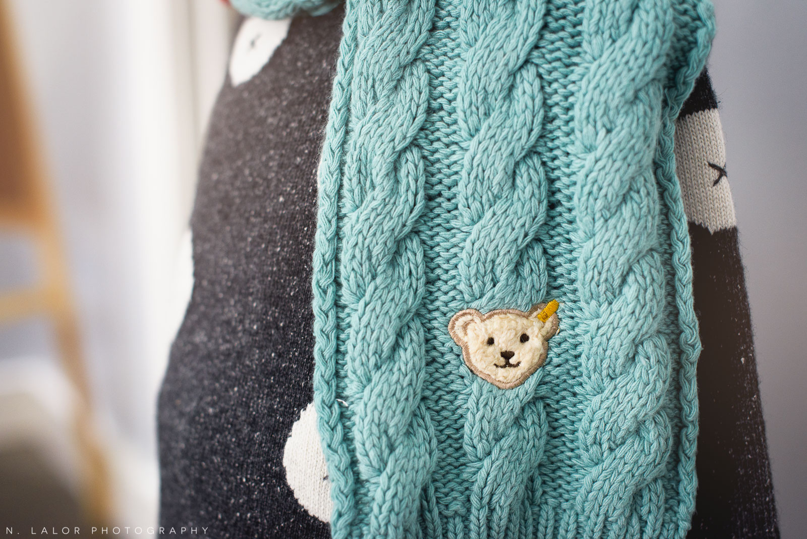 Fashionable and cute knit scarf by Steiff - only at Ella & Henry in New Canaan. Photo by N. Lalor Photography.