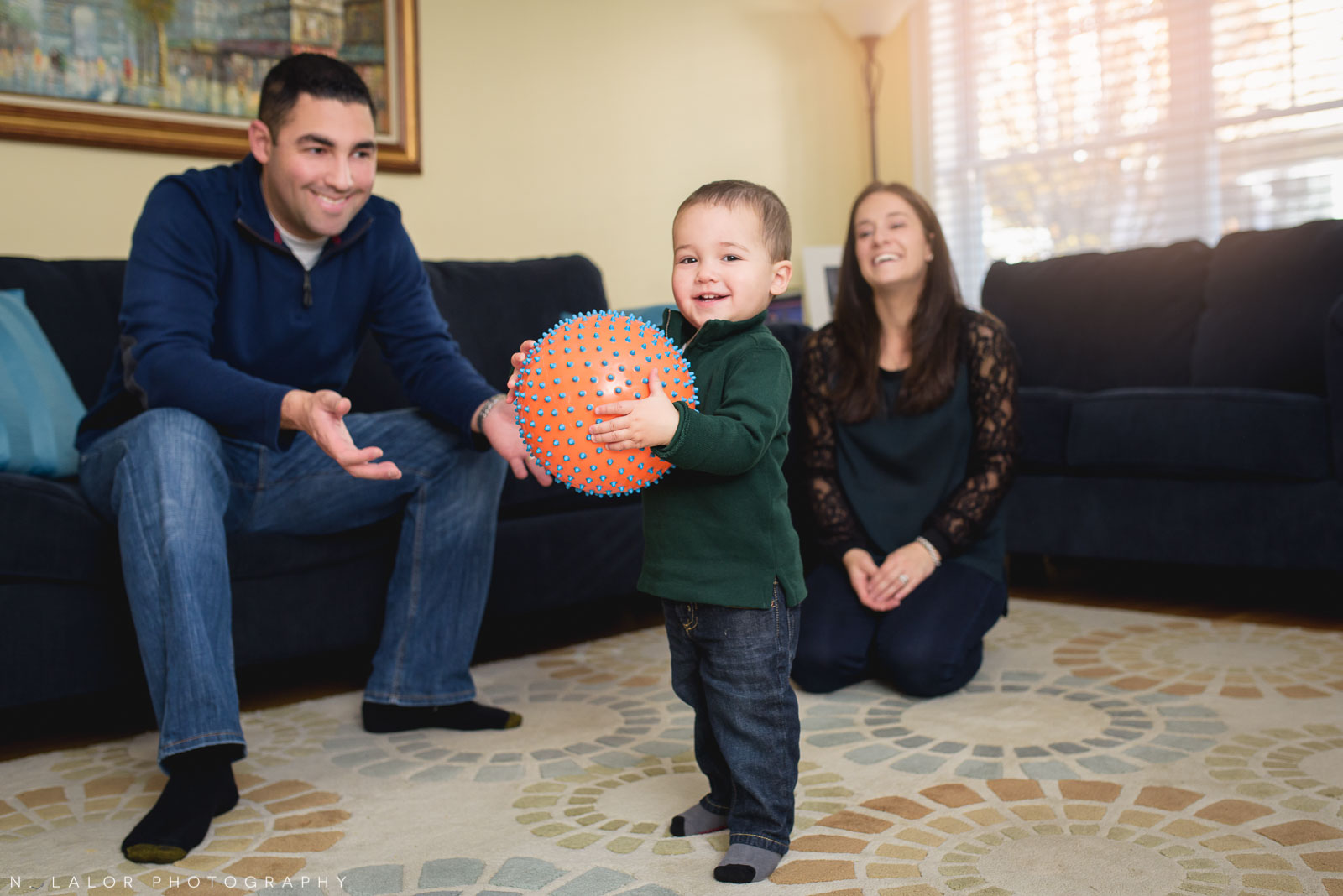 Playing ball in the living room. Lifestyle family photoshoot by N. Lalor Photography.