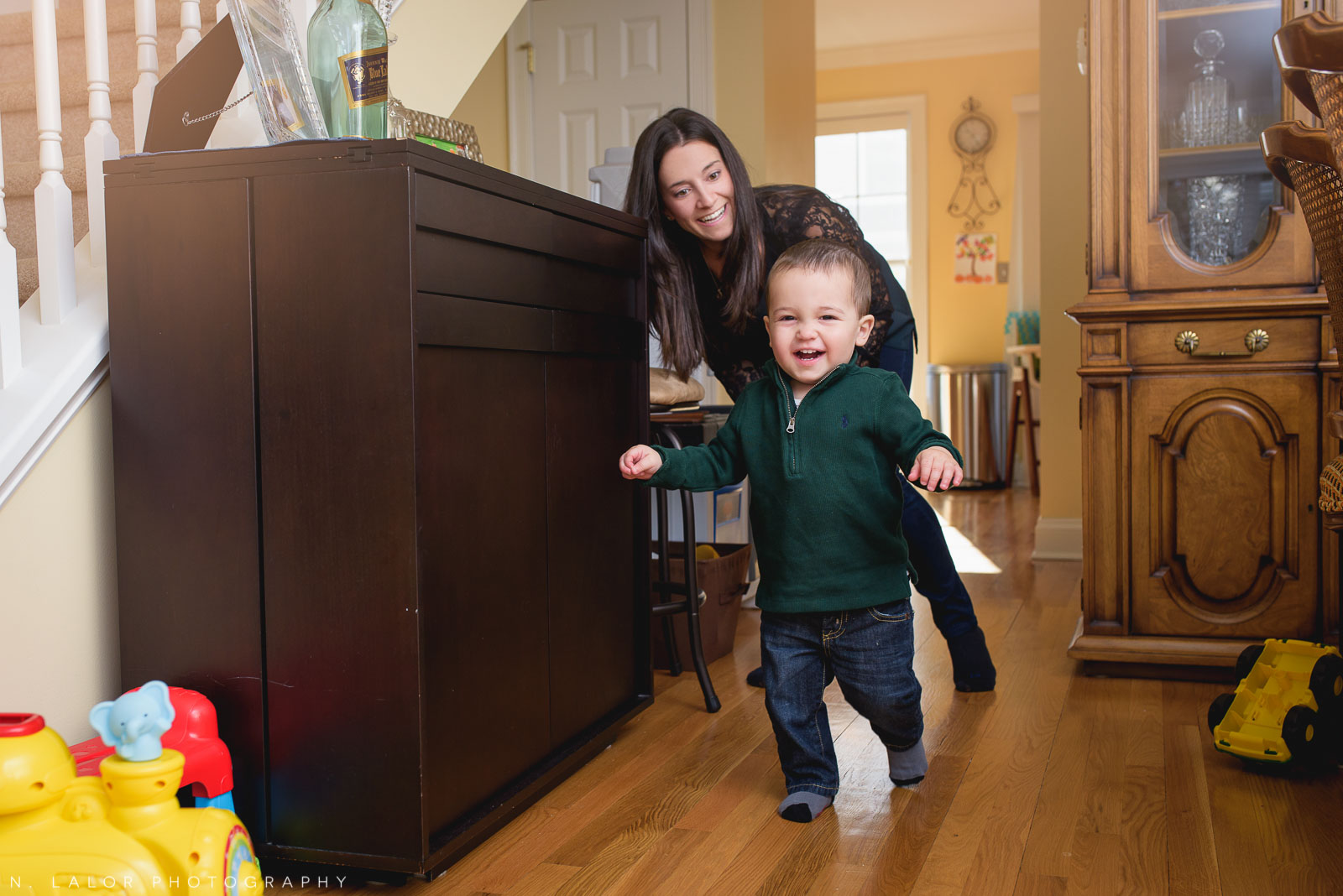Running around after a toddler. Candid family life photo by N. Lalor Photography.