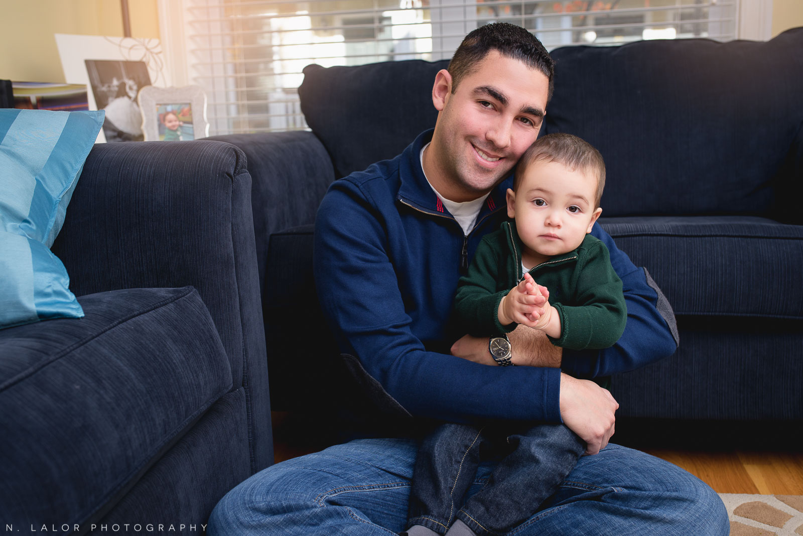Father and son in the living room. Connecticut family photo by N. Lalor Photography.