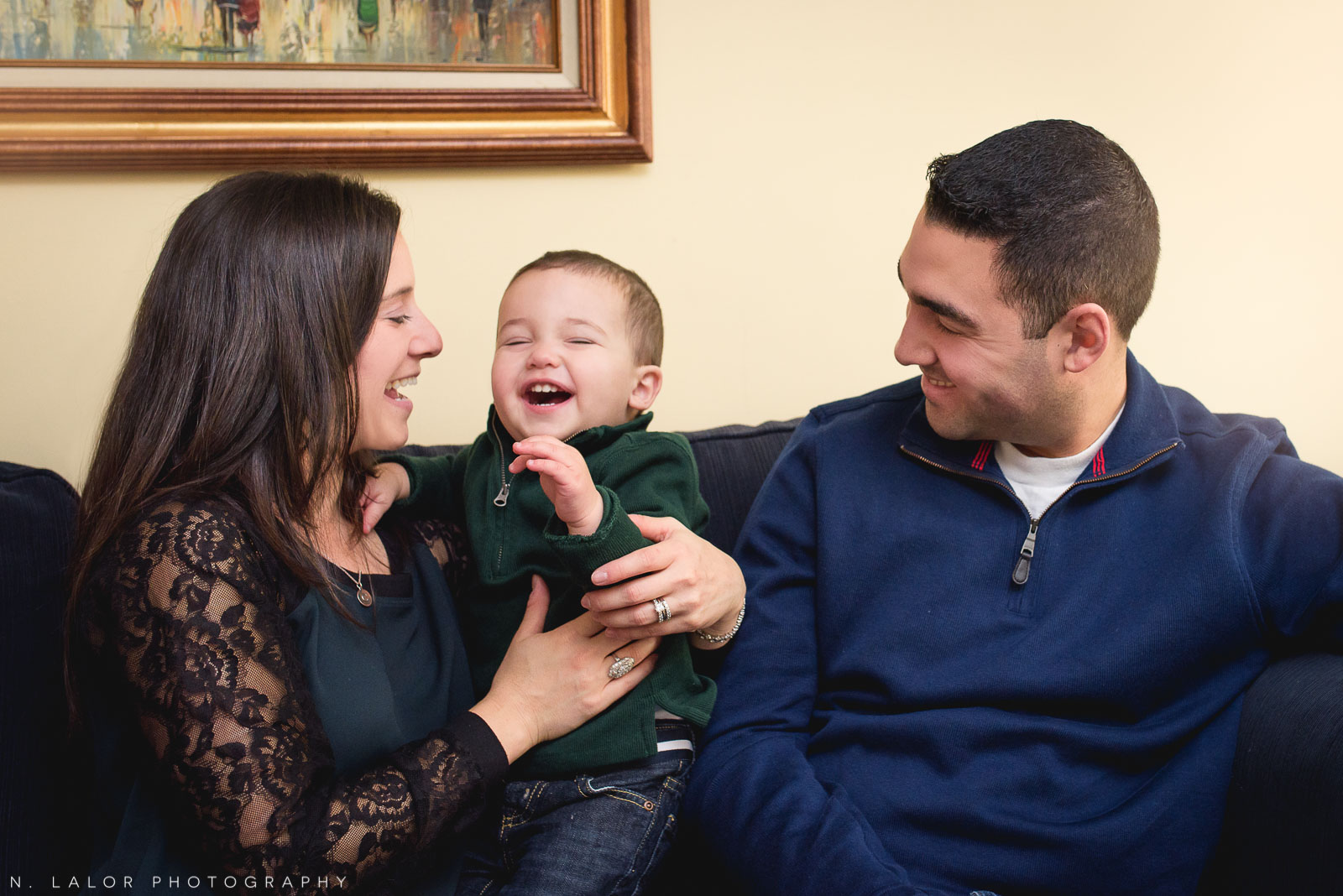 Family laughing together. Joyful lifestyle portrait by N. Lalor Photography.