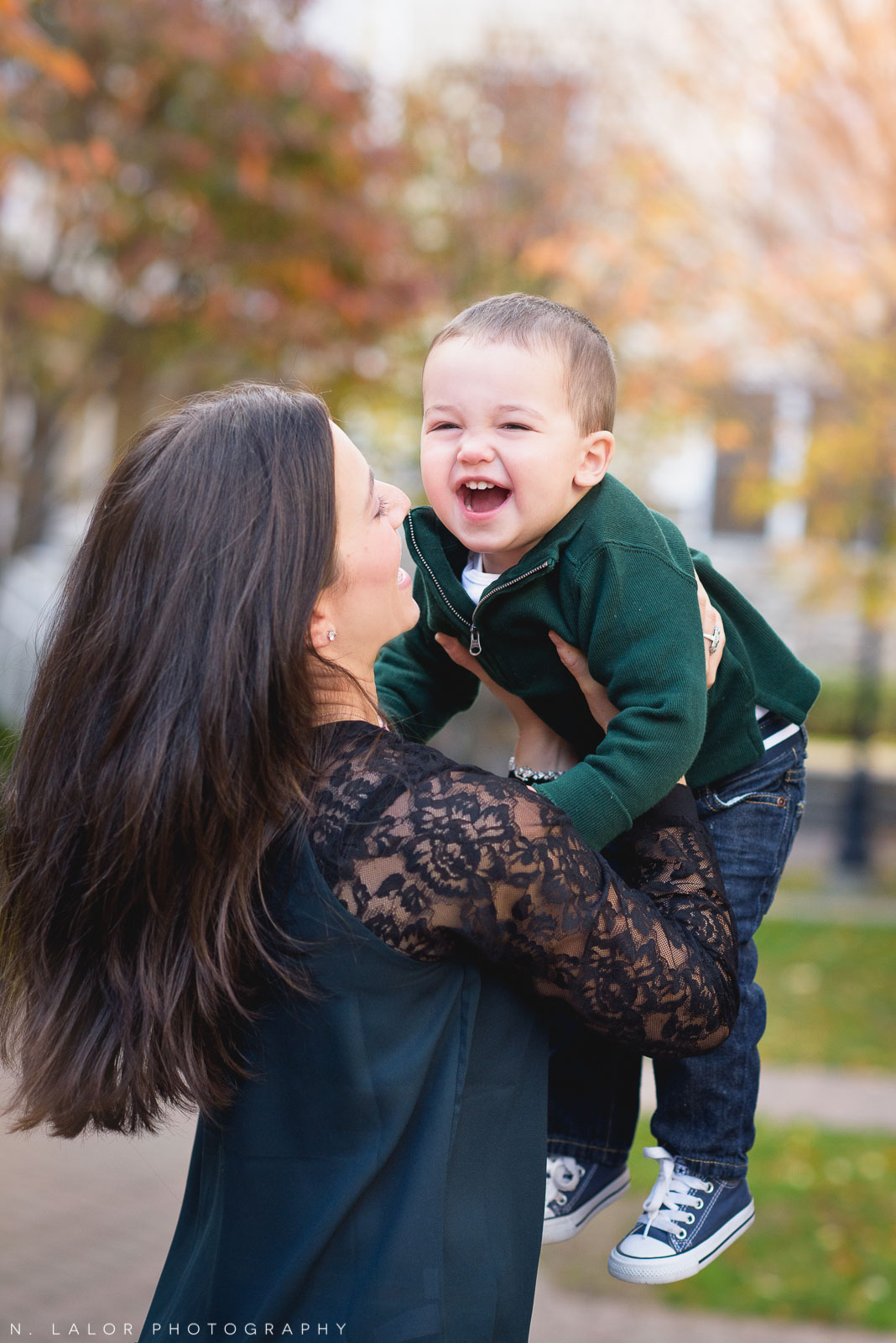 Mom and her joyful laughing toddler son. Lifestyle family portrait by N. Lalor Photography. Fairfield County, Connecticut.