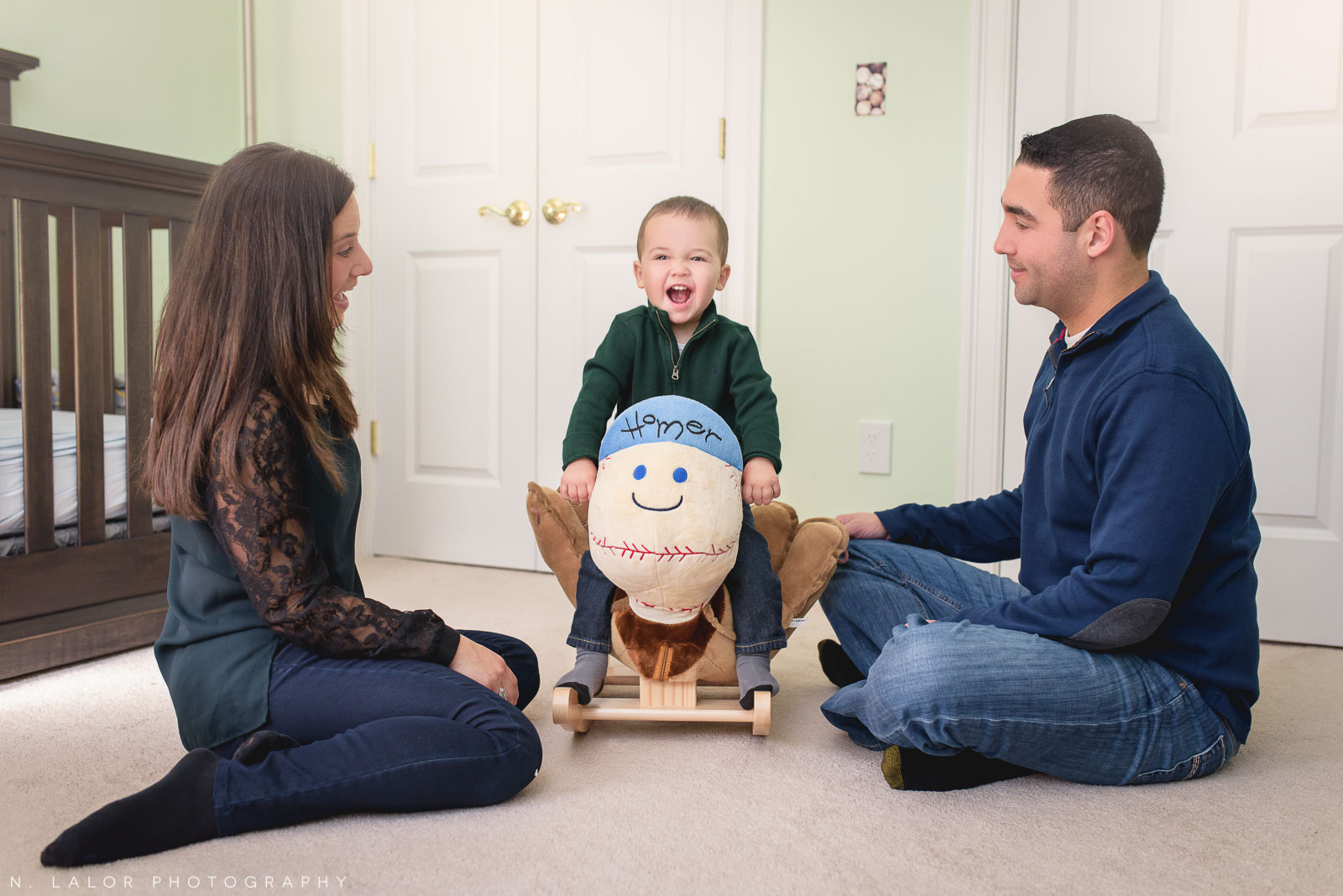 Mom and dad enjoying some fun play time with their toddler son. Lifestyle family portrait by N. Lalor Photography.