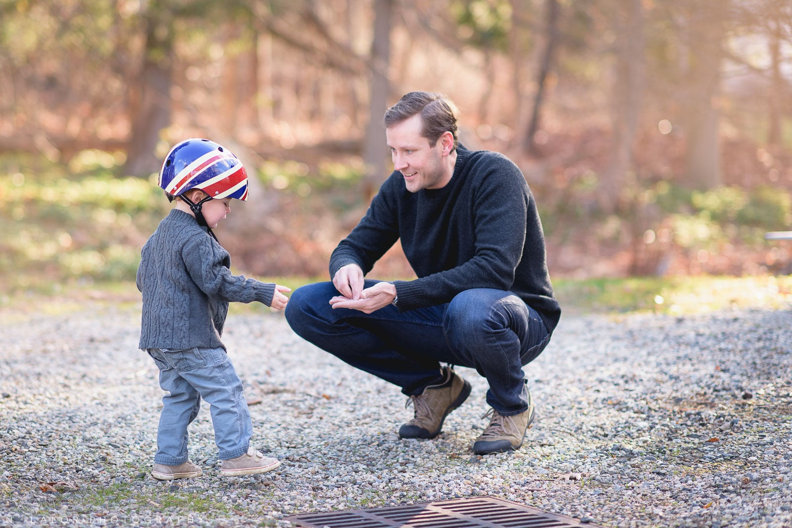 Dad spending outdoor time with his toddler son. Portrait by N. Lalor Photography.