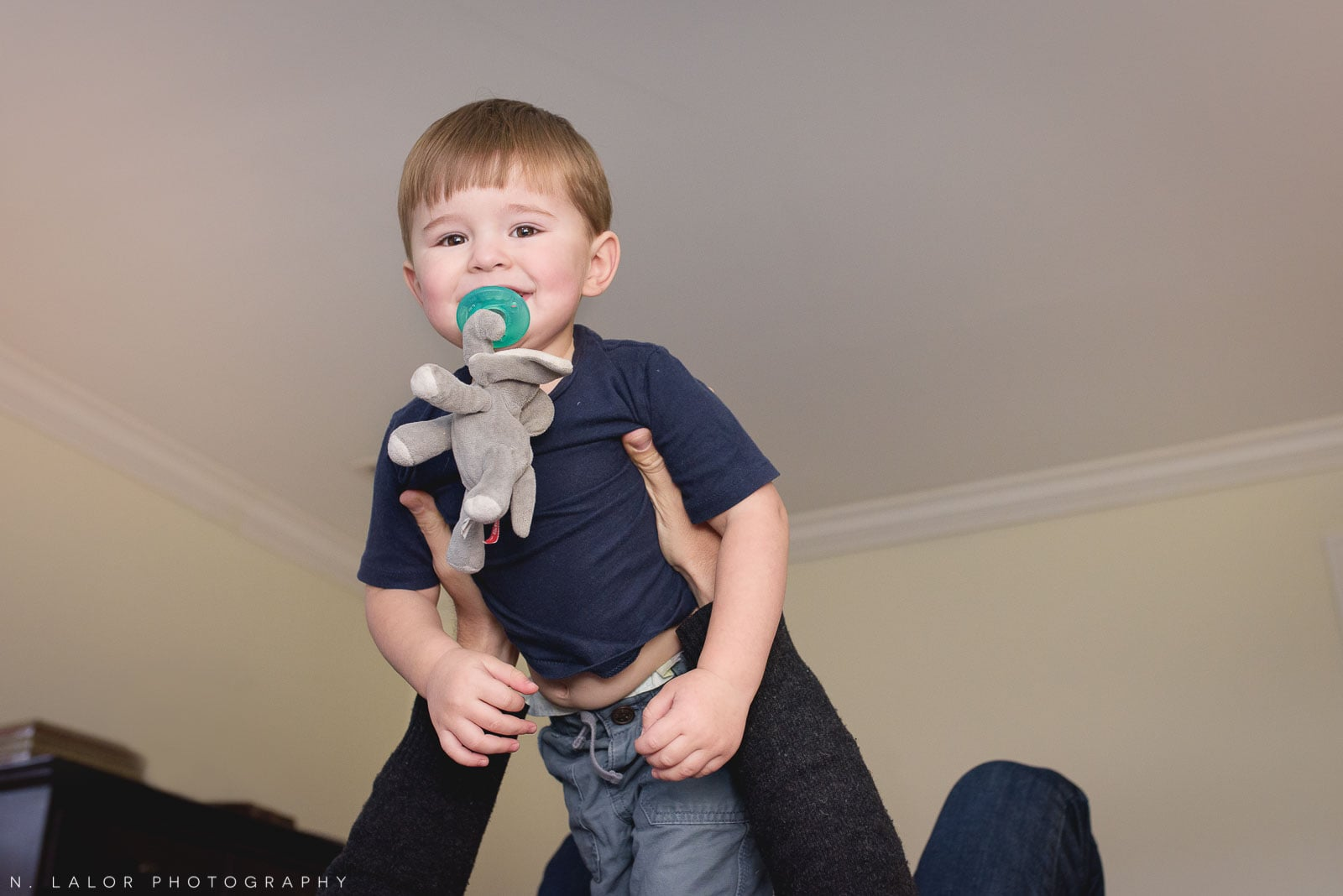 Lifestyle portrait of a toddler with his 'binky' by N. Lalor Photography.