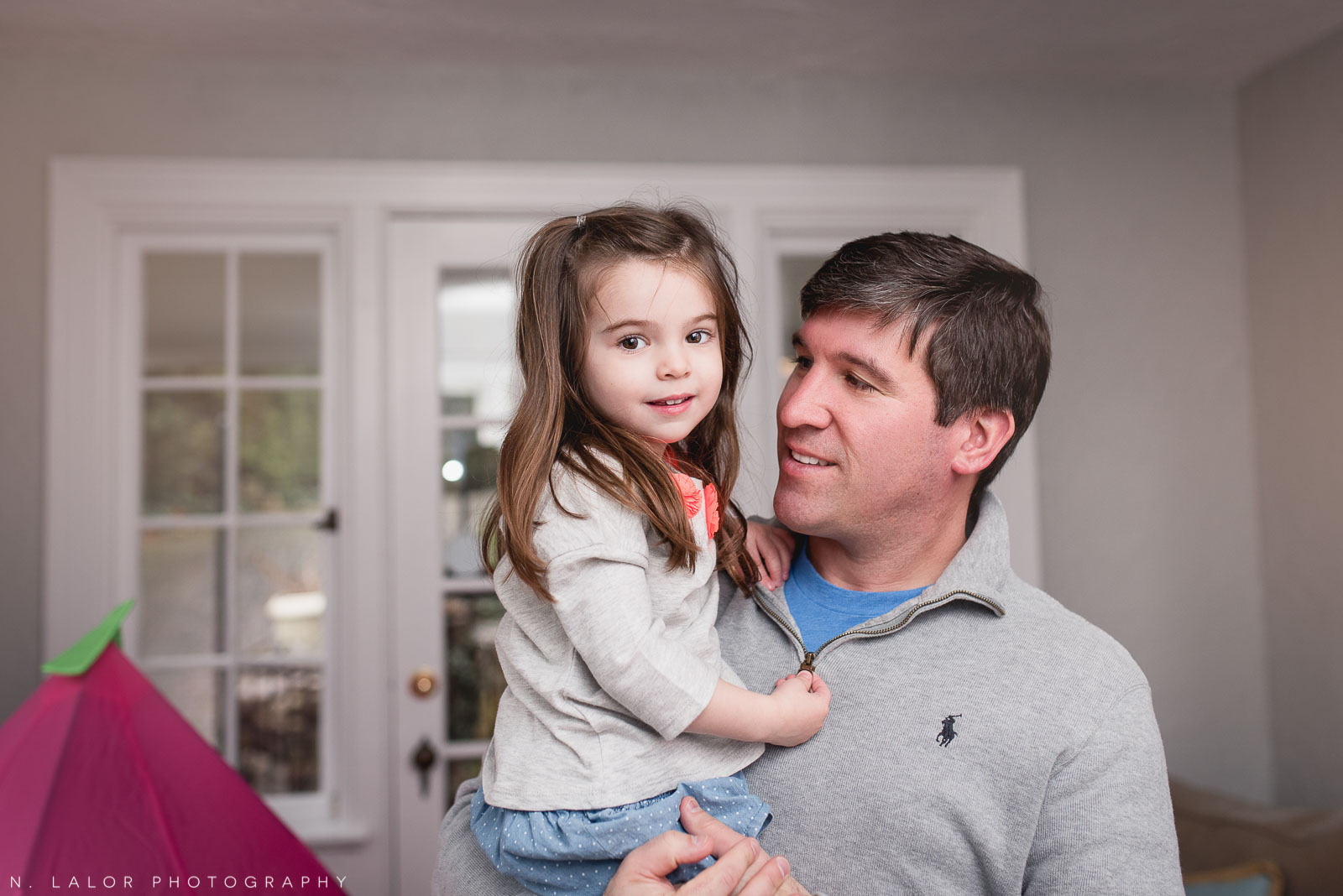 Dad and his 3-year old daughter. At-home family portrait by N. Lalor Photography.