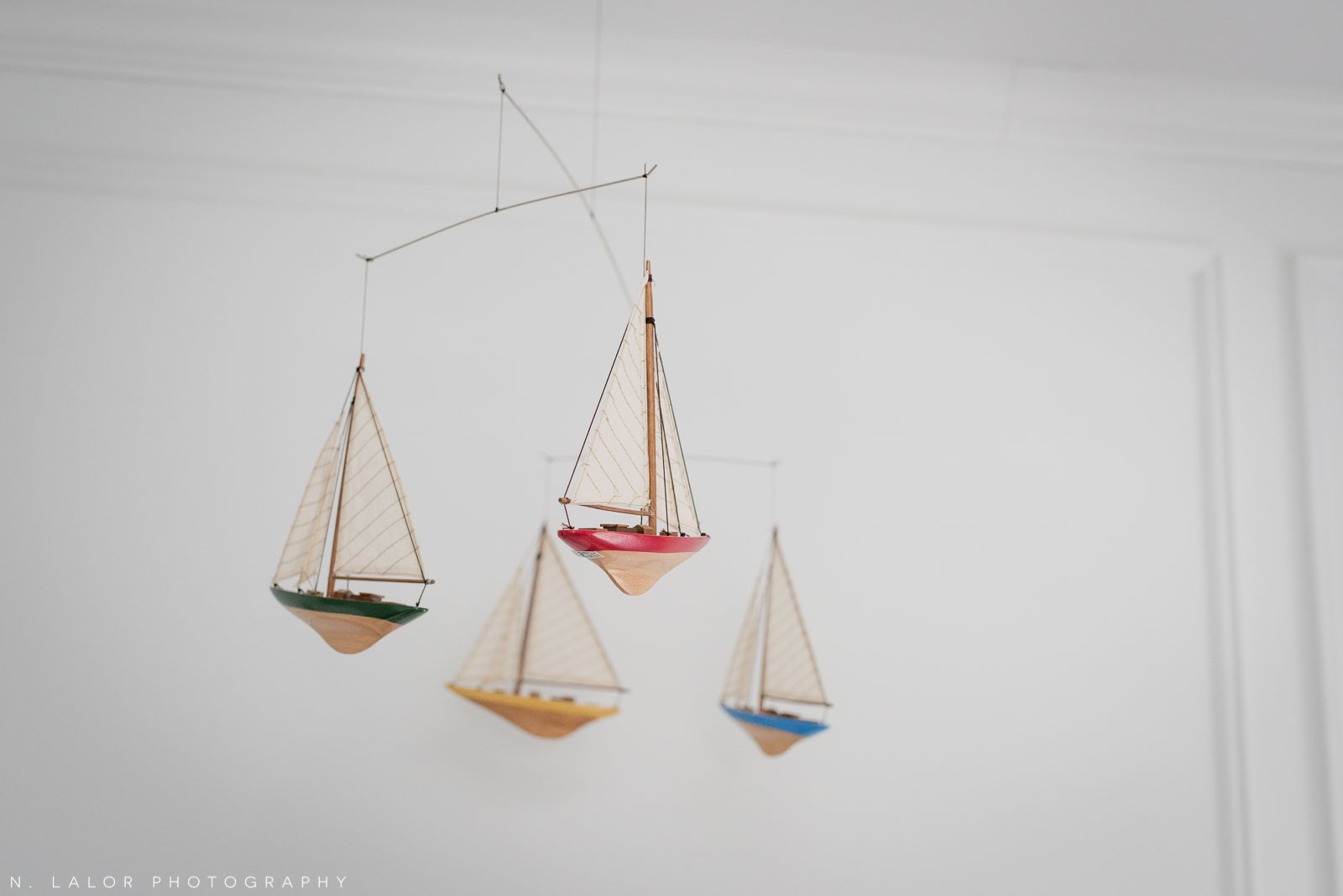 Boat mobile in baby boy's room. Photo by N. Lalor Photography.