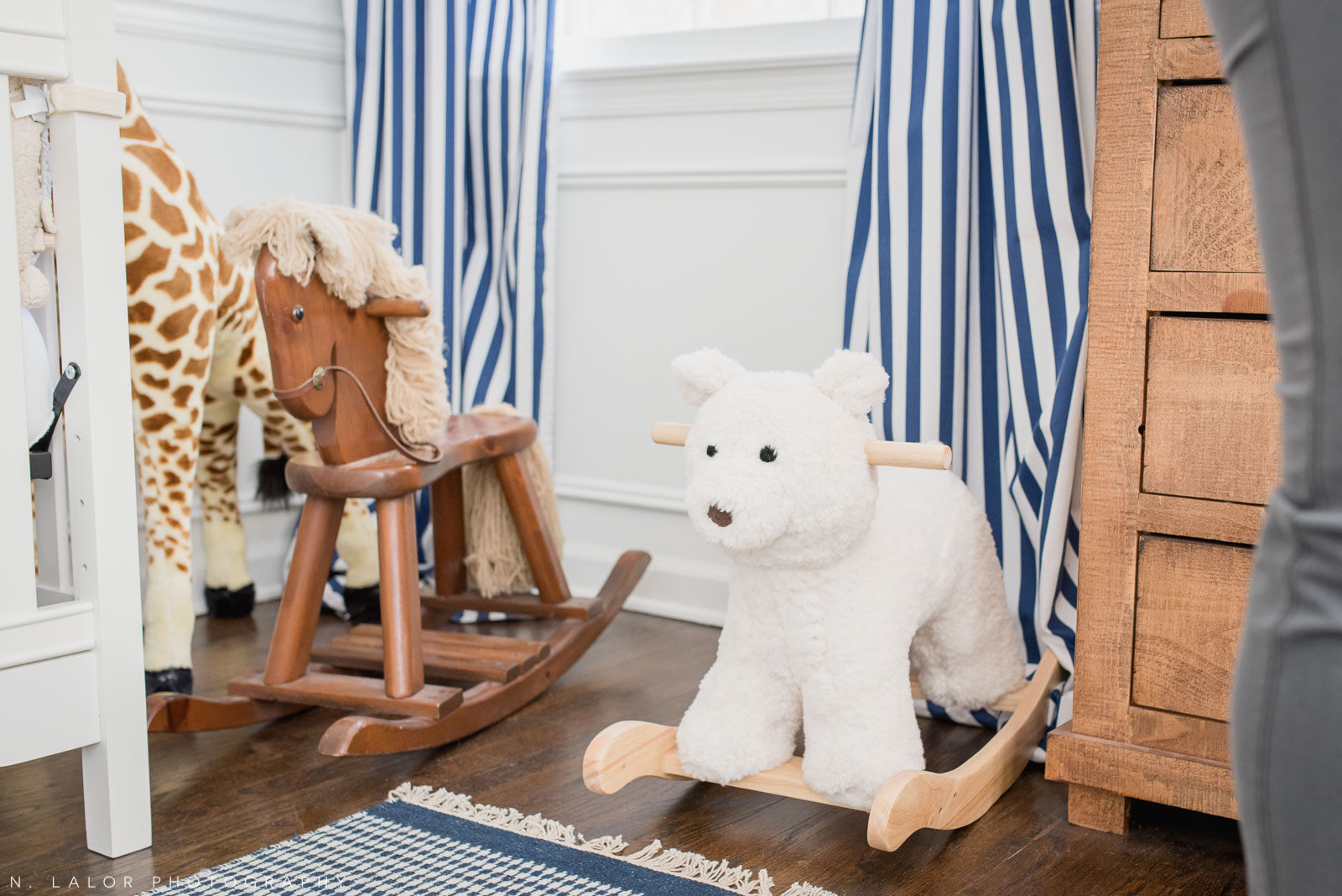 Baby boy nursery with rocking horse and bear. Photo by N. Lalor Photography.