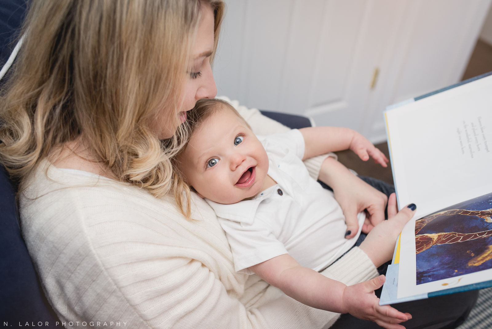 Baby boy reading with Mom. Lifestyle editorial portrait by N. Lalor Photography.