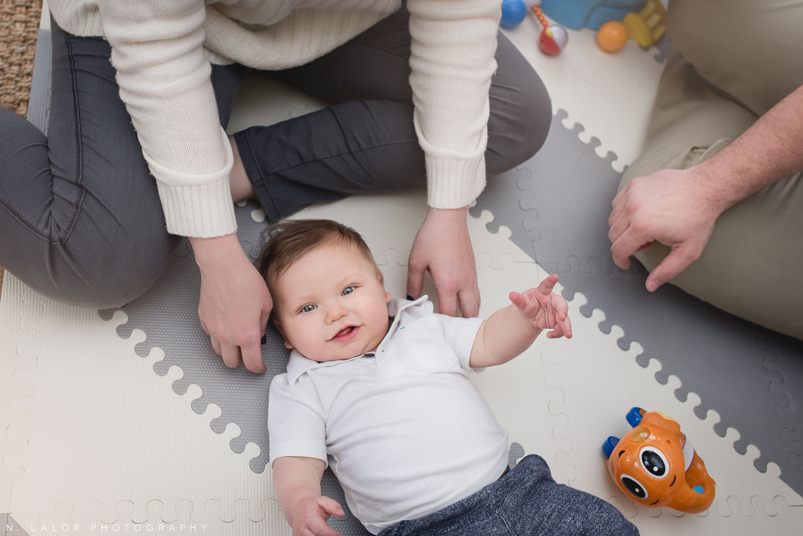 Baby boy on his play mat. Lifestyle family photo by N. Lalor Photography.