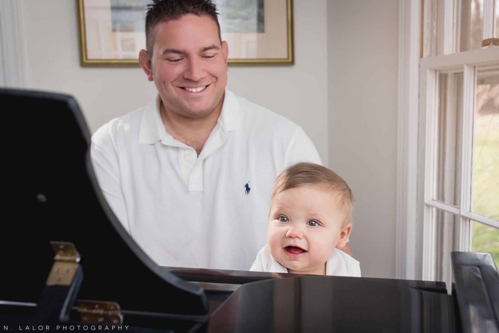 Playing piano with Dad. Lifestyle family photo session with N. Lalor Photography. Fairfield County, Connecticut.