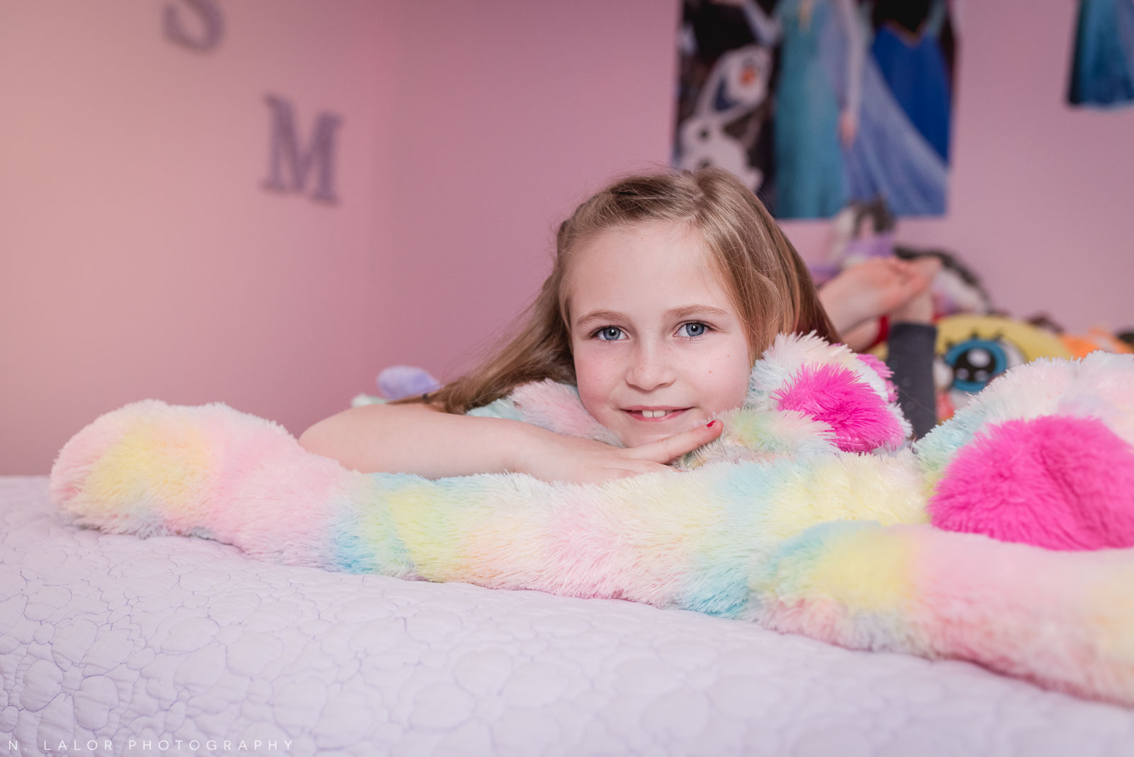 Portrait of a 7-year old girl in her room. Editorial-style family session with N. Lalor Photography. Darien Connecticut.