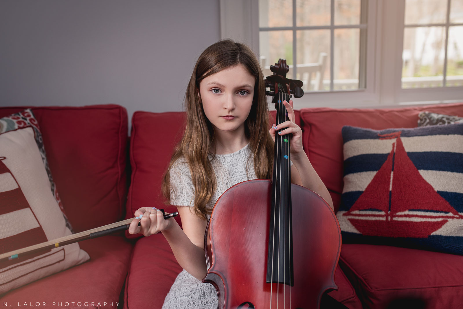 Portrait of a tween girl with her cello. Editorial-style photo by N. Lalor Photography. Darien, CT.