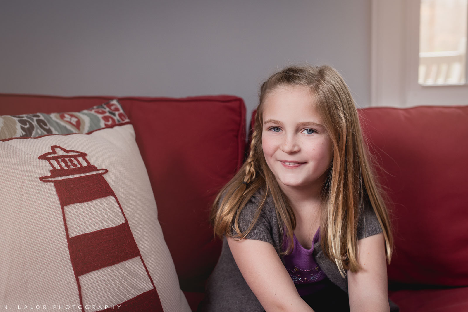 Portrait of a 7-year old girl at home. Lifestyle family session with N. Lalor Photography.