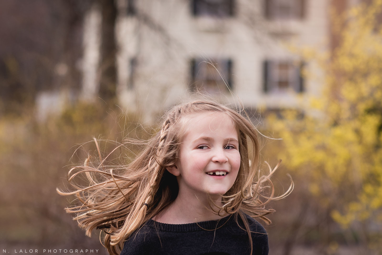 Artistic flying-hair portrait of a 7-year old girl. Editorial-style photo session with N. Lalor Photography. Darien, CT.