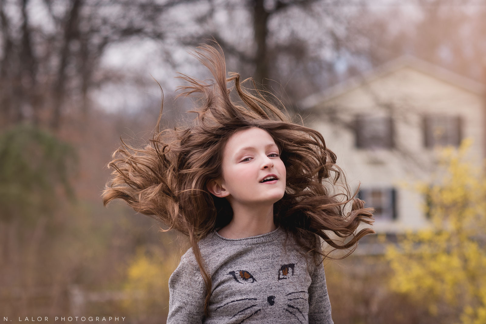 Artistic flying-hair portrait of a tween girl. Editorial-style photo session with N. Lalor Photography. Darien, CT.