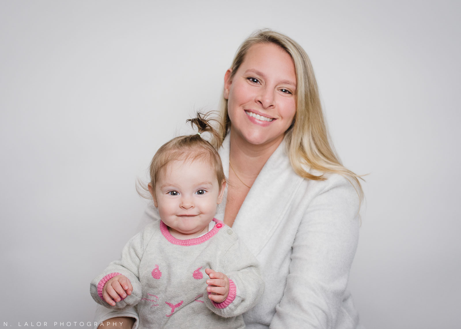 Mom with her baby. Mother's Day Mini Sessions with N. Lalor Photography. At Ella & Henry children's clothing store in New Canaan, Connecticut.