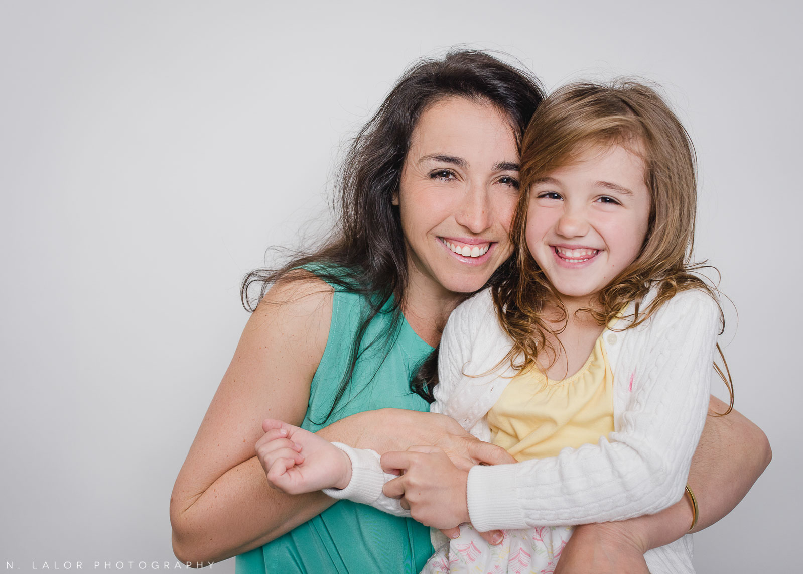 Mother daughter portrait. Mother's Day Mini Sessions with N. Lalor Photography. At Ella & Henry children's clothing store in New Canaan, Connecticut.