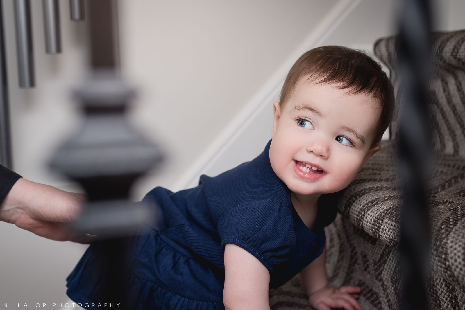Eager 1-year old climbing the stairs. Lifestyle family session by .N. Lalor Photography