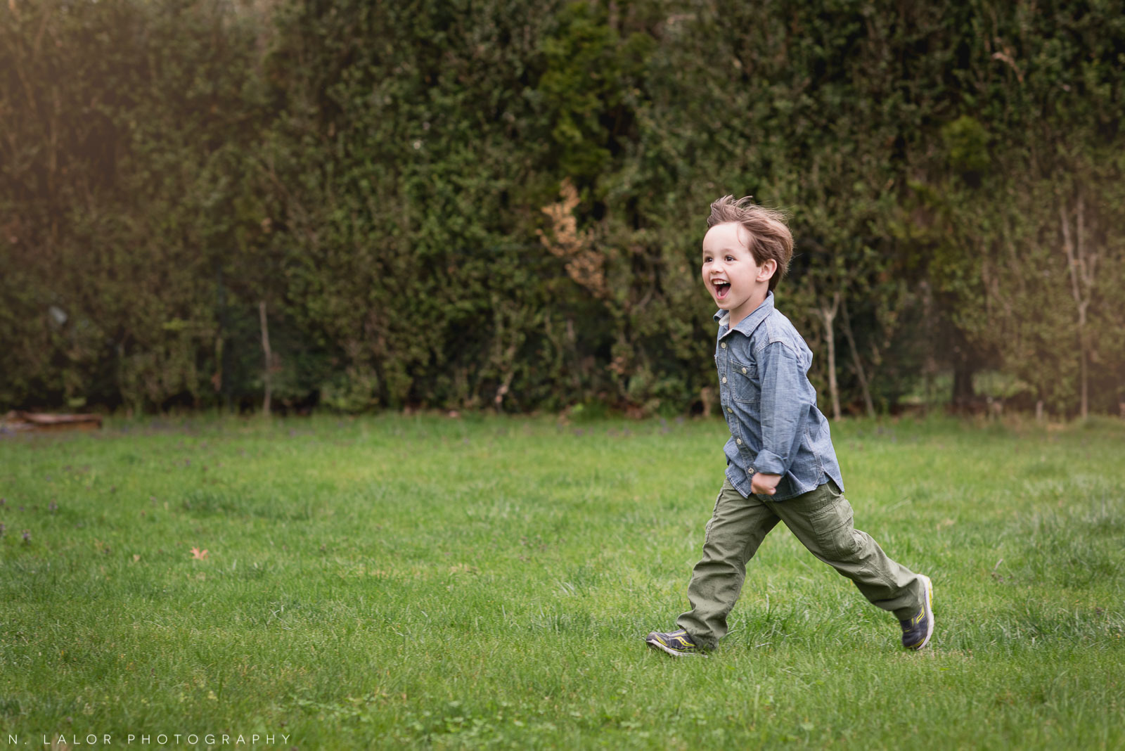 Running in the back yard. Lifestyle family session with N. Lalor Photography.