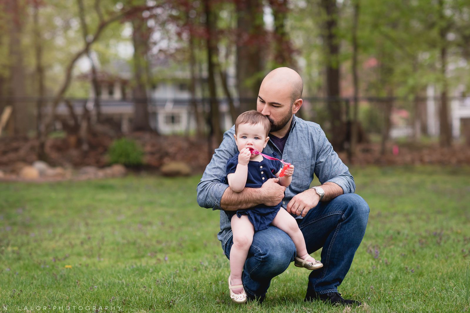 Father with his 1-year old daughter. Outdoor lifestyle image by N. Lalor Photography.