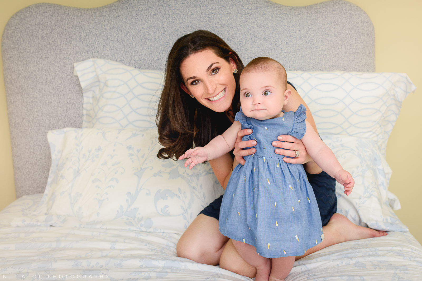 Mom with her baby girl. Lifestyle, editorial session with N. Lalor Photography in New Canaan, CT.