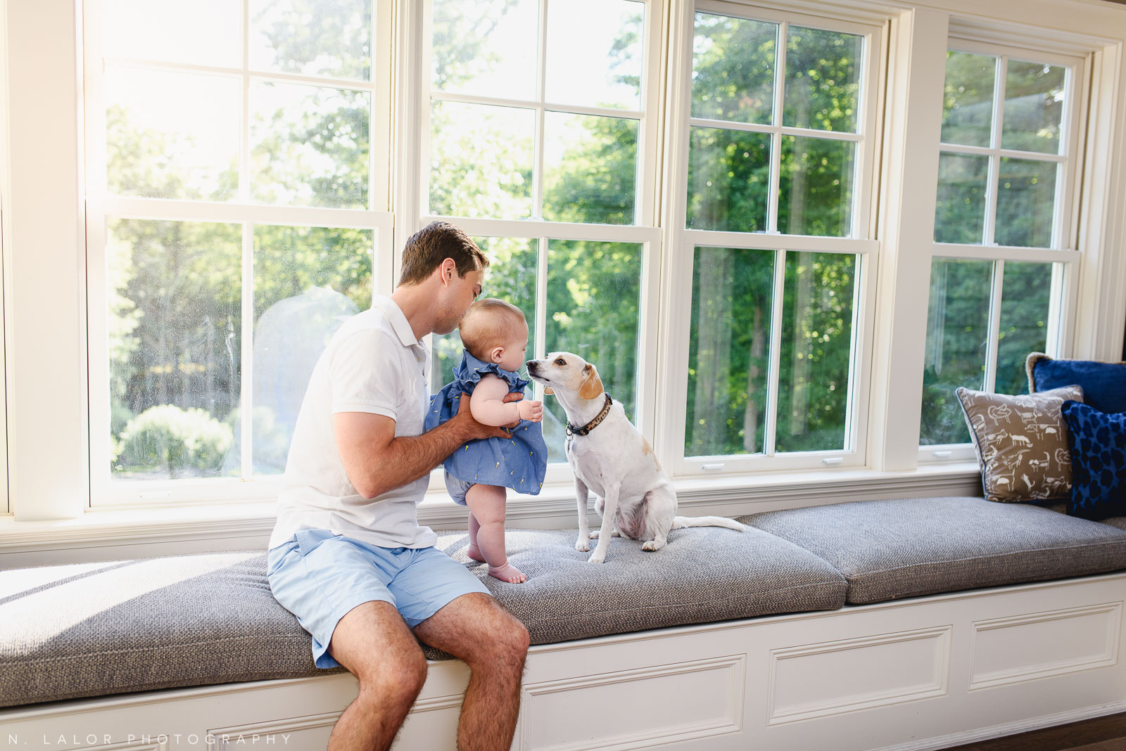 Dad and baby daughter with the dog. In-home family session with N. Lalor Photography in New Canaan, CT.