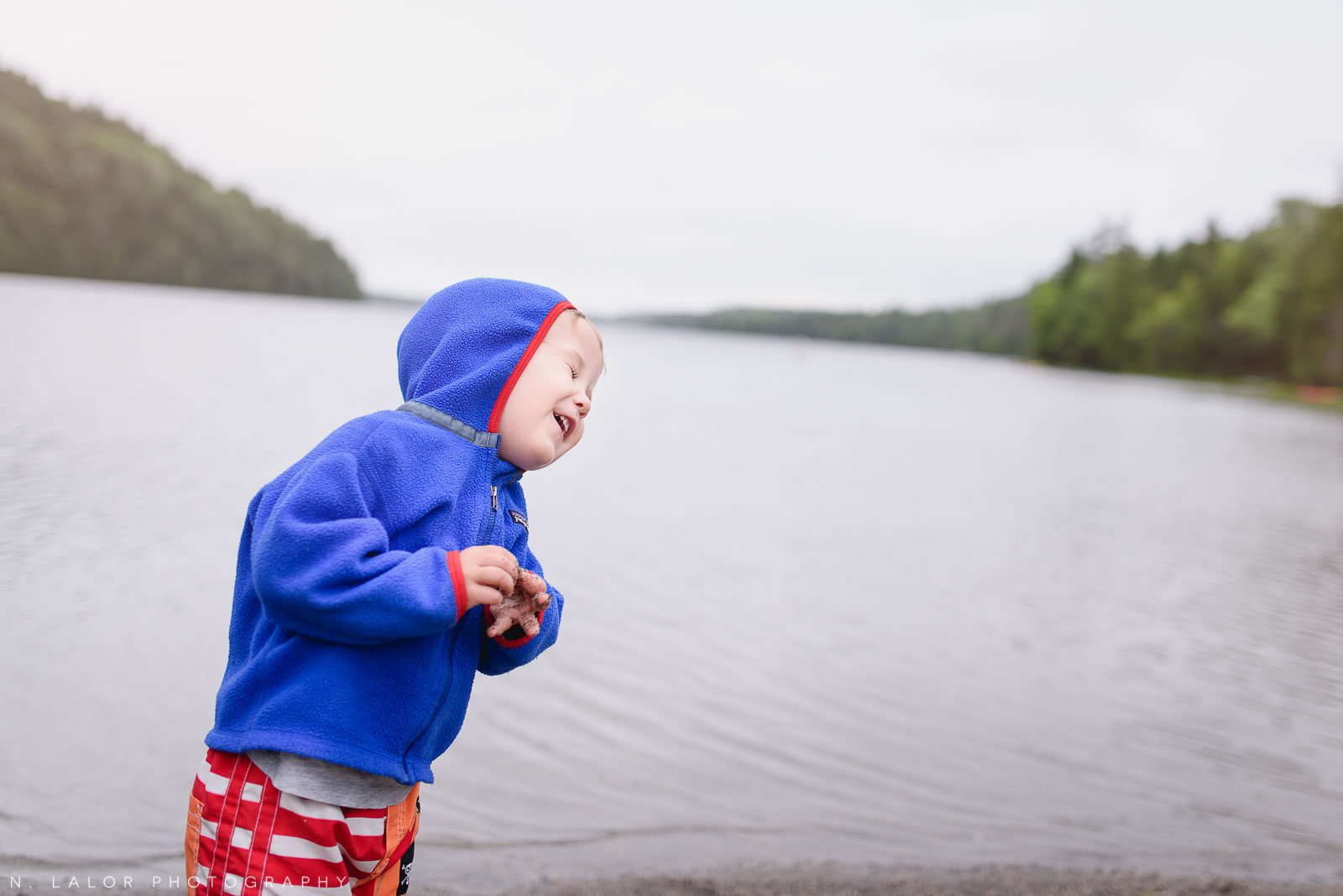 Toddler and his rock, that is about to get thrown into the water. Acadia National Park in Bar Harbor Maine. Photo by N Lalor Photography.