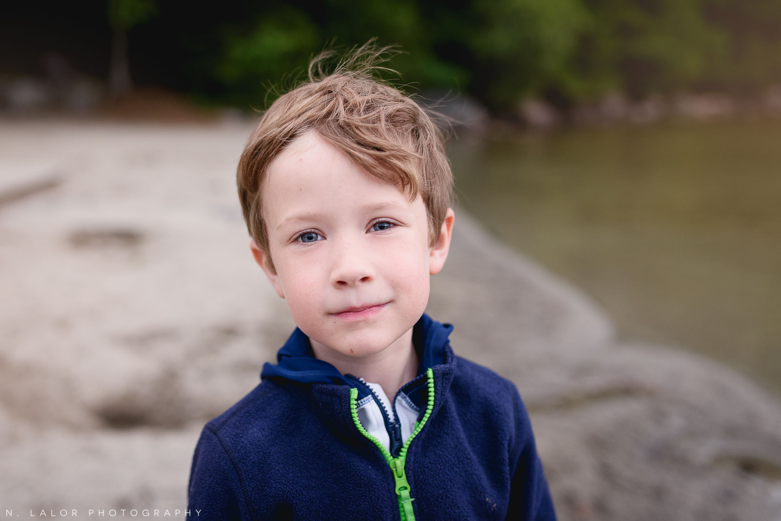 A 6-year old that is willing to actually look at the camera. Acadia National Park in Bar Harbor Maine. Photo by N Lalor Photography.