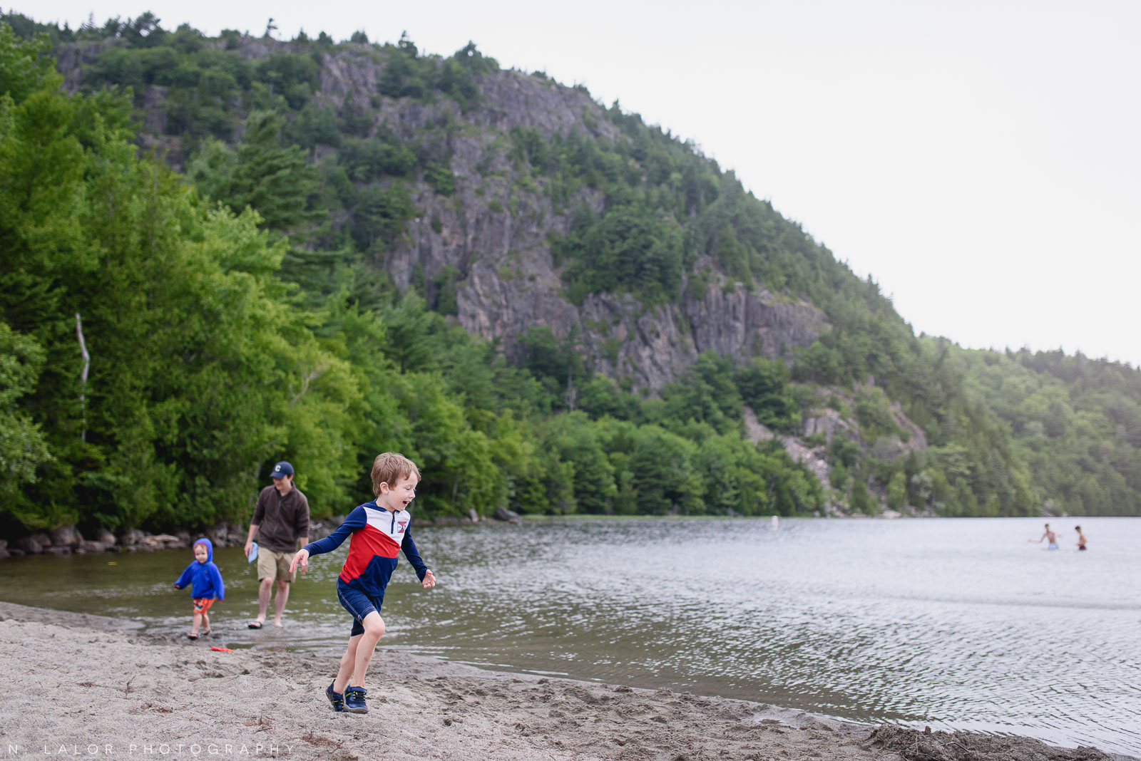 Family vacation with little kids. Catch them if you can. Acadia National Park in Bar Harbor Maine. Photo by N Lalor Photography.