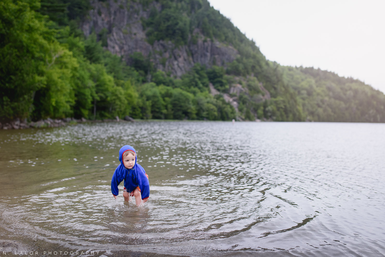 It's a little cold to be swimming there, toddler. Acadia National Park in Bar Harbor Maine. Photo by N Lalor Photography.
