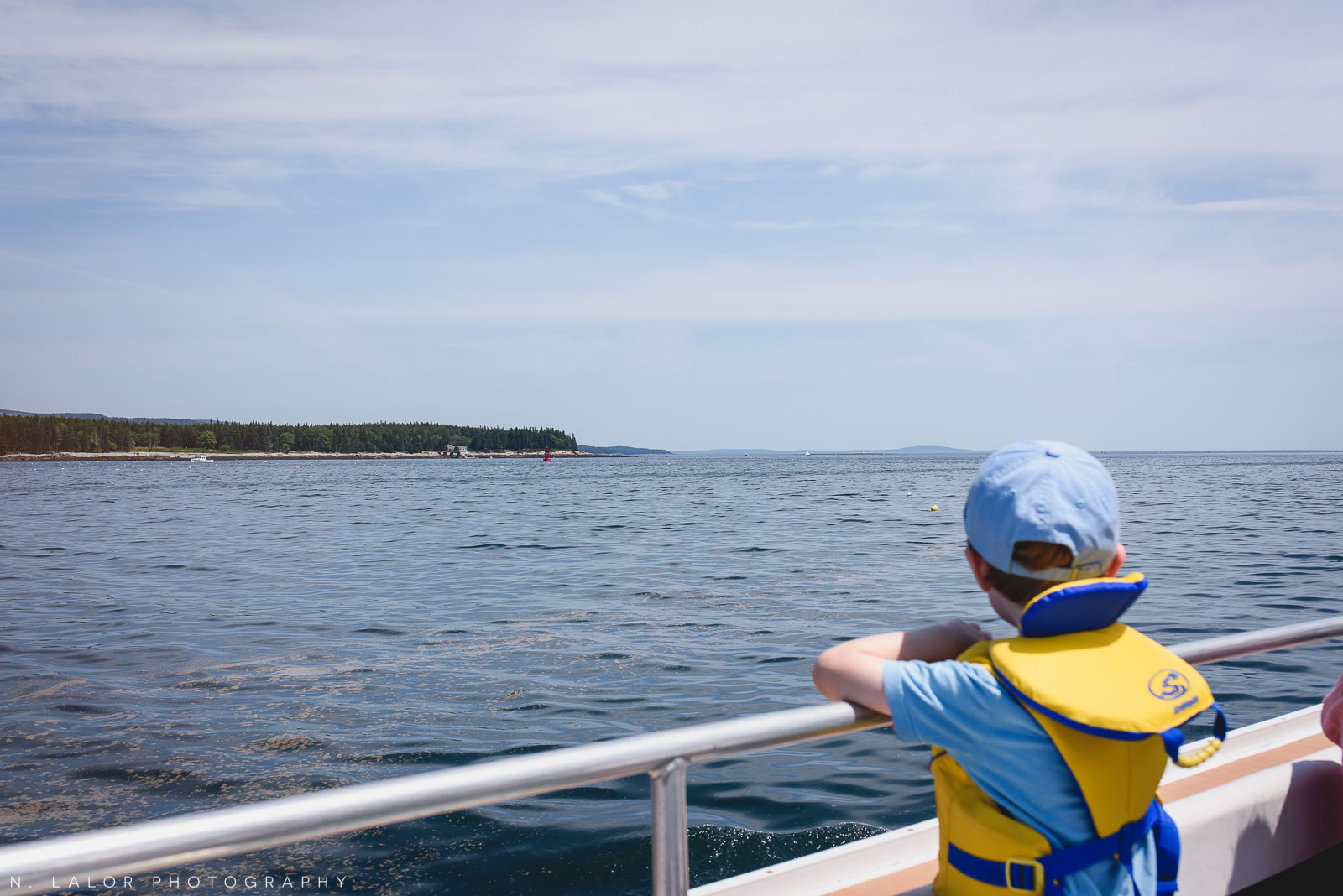 Looking for buoys during a boat rid. Acadia National Park in Bar Harbor Maine. Photo by N Lalor Photography.