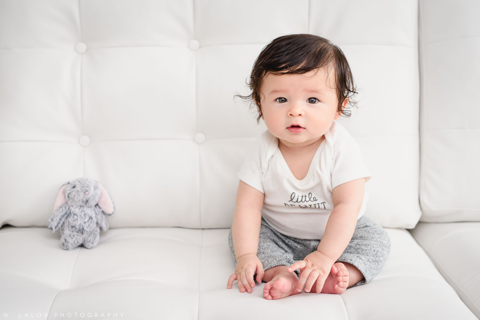 On the couch with his best friend. 6-month old baby studio photoshoot with N. Lalor Photography in Greenwich, Connecticut.
