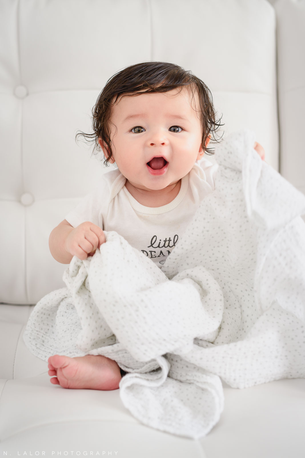 Favorite toy, a blanket! 6-month old baby studio photoshoot with N. Lalor Photography in Greenwich, Connecticut.