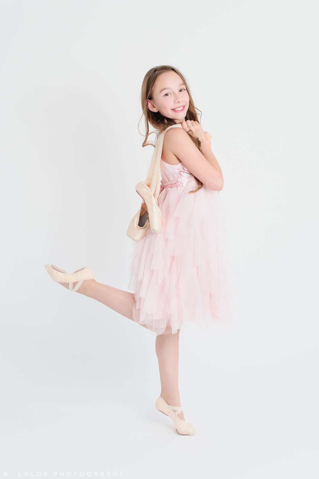 Posing with pointe shoes. Ballerina photoshoot with N. Lalor Photography. Greenwich, Connecticut.