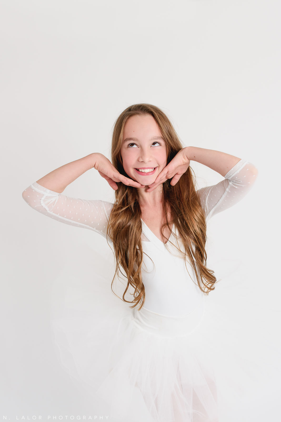 Being silly. Tween ballerina photoshoot with N. Lalor Photography. Greenwich, Connecticut.