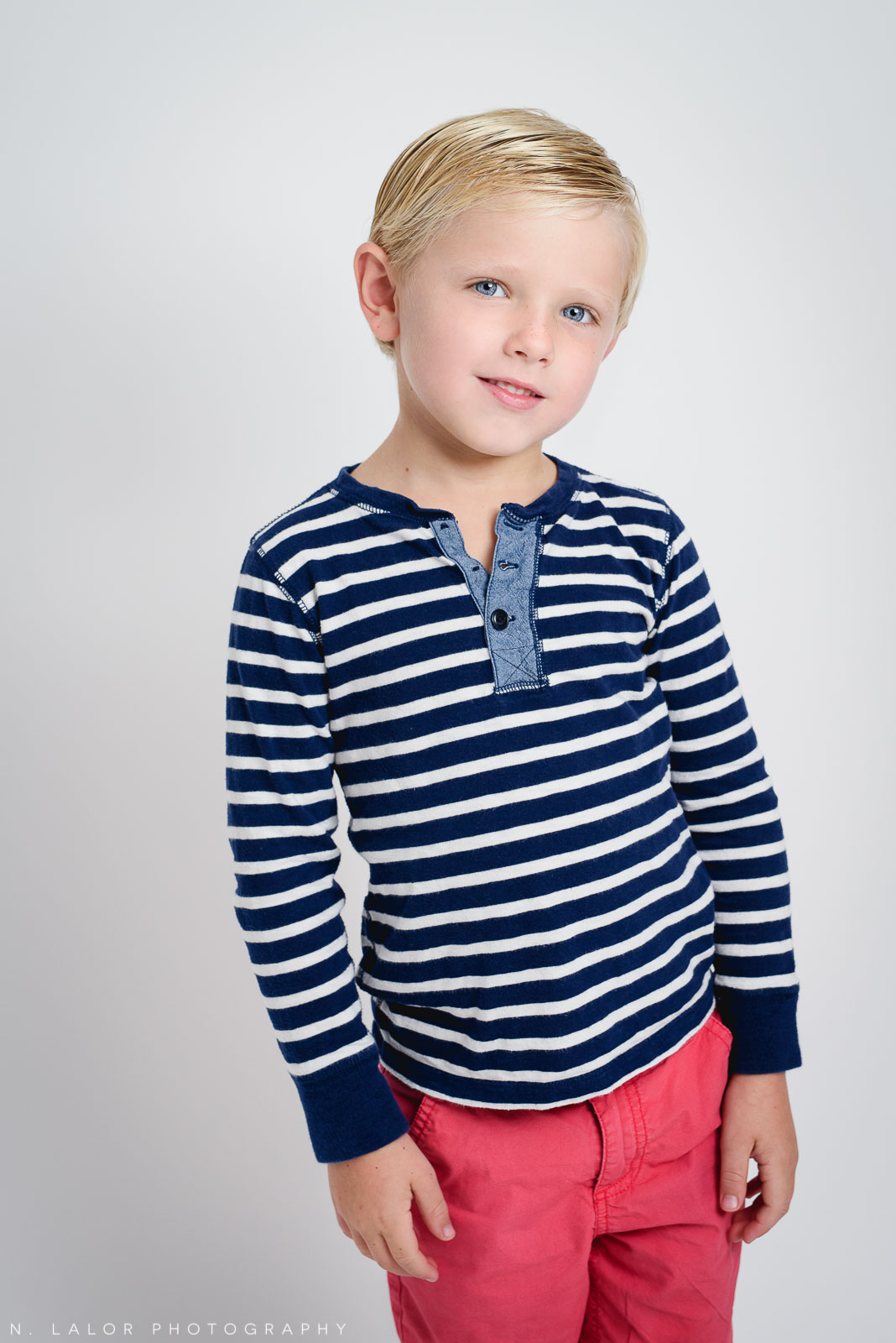 Striped shirt, boy portrait. Studio photoshoot with N. Lalor Photography in Greenwich, Connecticut.