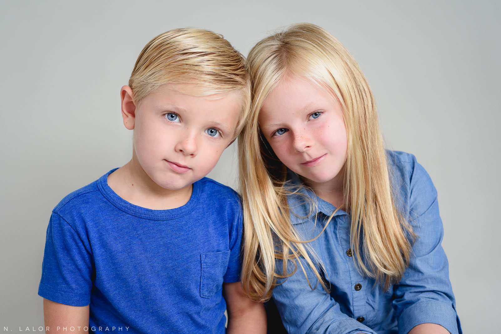 Siblings, being serious. Studio photoshoot with N. Lalor Photography in Greenwich, Connecticut.