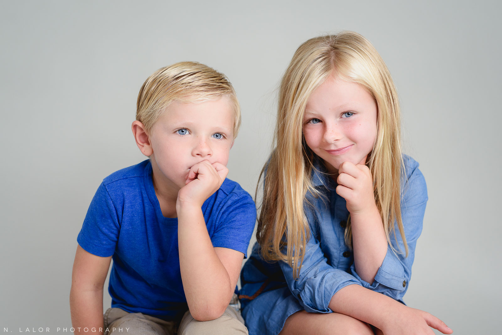 Brother and sister, being themselves. Studio photoshoot with N. Lalor Photography in Greenwich, Connecticut.